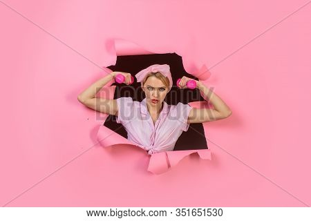 Woman In Sport Equipment. Serious Woman With Dumbbells Looking Through Paper. Sporty Fitness Woman T