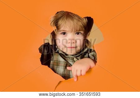 Kids. Cute Child Peeping Through Hole In Paper. Advertise Childrens Goods. Advertising. Banner. Happ