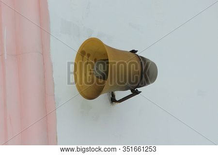 Old Street Loudspeaker Attached To The Wall Of The House. Stock Photo For Web And Print With Empty S