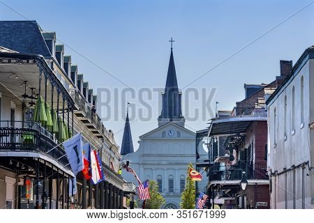 New Orleans, Louisiana, United States - October 6, 2019 Orleans Street And Bourbon Street Flags Hote