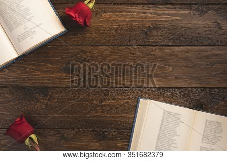 Romantic Concept. Open Books With Poems And Roses, On Wooden Background. Flat Lay, Top View, Copy Sp