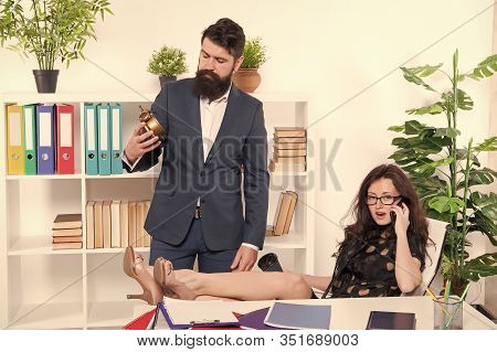 Time Is Short. Start Now. Bearded Man Hold Clock While Sexy Woman Talking On Phone. Work Time Or Wor