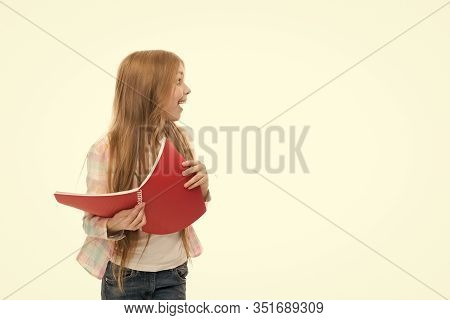 Back To School Goods. Cute Little Girl Holding School Exercise Book. Adorable Small School Child Wit