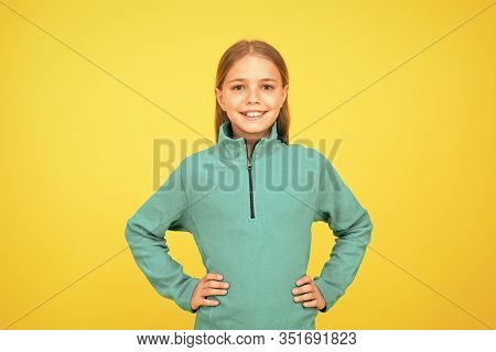 Little Girl. Small Child On Yellow Background. Child Care Concept. Preteen Girl Smiling Expression.