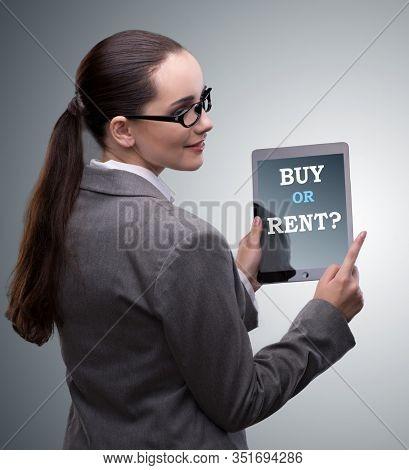 Businesswoman facing dilemma of buying versus renting