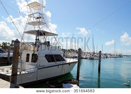 Charter Deep Sea Fishing Boat Equipped With A Tuna Tower Docked At A Marina On Key Biscayne,florida.