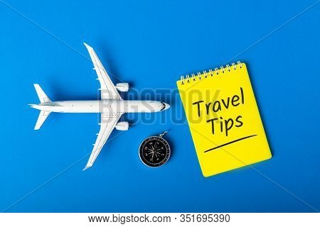 Travel Tips - Notepad, Compas And Toy Airplane On Blue Background. Summer Travel Concept 2020