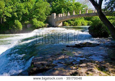 Bridge over rushing water