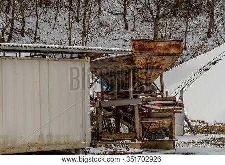 Conveyer Belt Next To Metal Building.