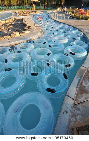 Many Inner Tubes Floating In Pool At Water Park