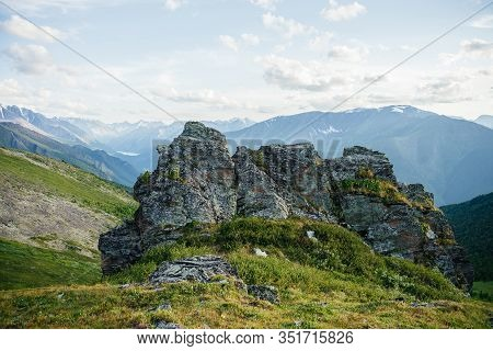 Scenic Mountain Landscape With Great Sharp Rock On Hillside. Awesome Alpine Scenery With Beautiful P