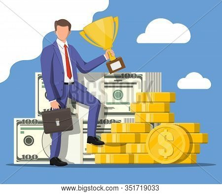 Successful Businessman With Dollar And Coins Holding Trophy, Celebrates His Victory. Business Succes