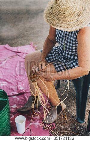 Old Female Weaving Basket On The Craft Workshop. Hands Holding The Craftwork, Close Up Shot.