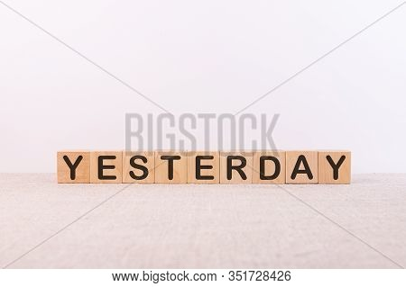Word Yesterday Made From Wooden Cubes On A Light Background