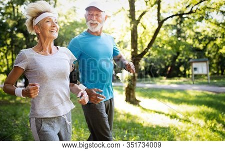 Happy Mature People Couple Exercising For Healthy Life