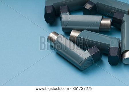 Set Of Inhalers For The Treatment Of Bronchial Asthma On A Blue  Background