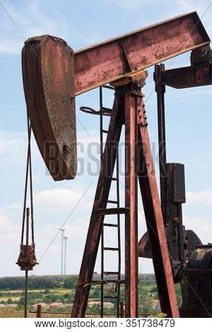 Oil well and windmills in Ayoluengo de la Lora, Burgo Province, Castilla Leon in Spain.