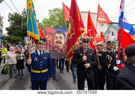 Anapa, Russia - May 9, 2019: Veterans Carry A Portrait Of Stalin At A Celebration In Honor Of Victor