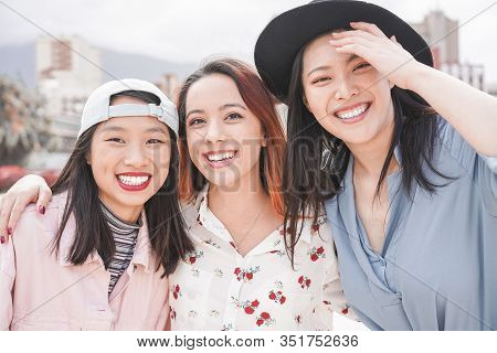 Asian Women Friends Having Fun Outdoor - Happy Trendy Girls Laughing Together - Millennial Generatio