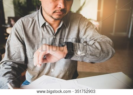 Professional Business Man Seeing Wristwatch To Check Time At Office.young Businessman Look At Clock