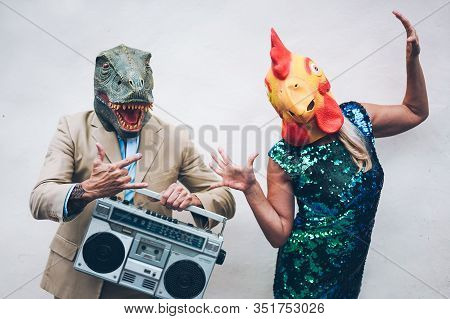 Crazy Senior Couple Dancing For New Year's Eve Party Wearing T-rex And Chicken Mask - Old Trendy Peo