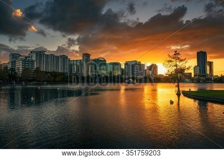 Colorful Sunset Above Lake Eola And City Skyline Viewed From The Eola Park In Orlando, Florida.