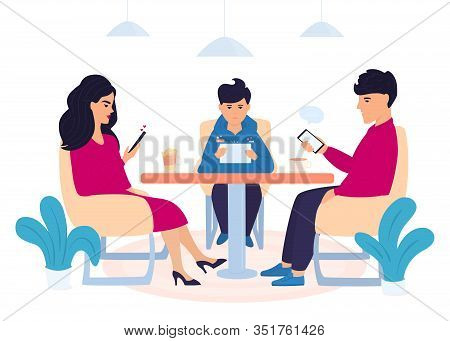 Digital Addiction. A Family With A Teenage Son Are Sitting In A Cafe And Using Gadgets. Man Chatting