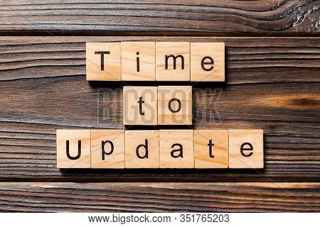 Time To Update Word Written On Wood Block. Time To Update Text On Wooden Table For Your Desing, Top