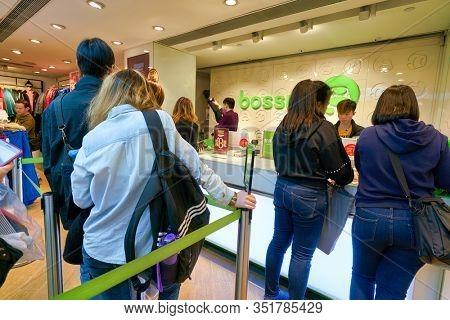 HONG KONG - JANUARY 22, 2019: people queue at Bossini shop in Hong Kong.
