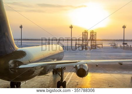 The Plane Stands In The Hangar At Sunrise. A Frosty Day And An Airplane, View From The Back. Prepari