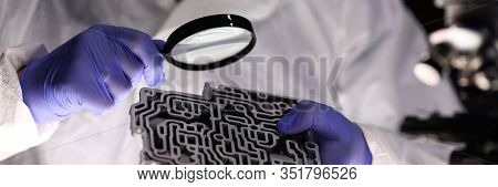 Man Examines Spare Part An Automatic Transmission. Examination Manufacturing Defects And Operational
