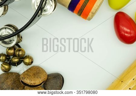 Top View Of Percussion Instruments Forming A Frame On A White Background. Acoustic Instruments Conce