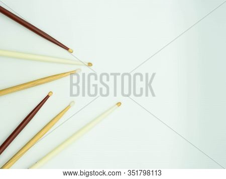 Top View Of Drumsticks On The Left Of The Image On A White Background , With Space To The Right Of T
