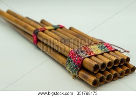 Zampoña. Close-up View Of Peruvian Pan Flute Isolated On A White Background. Andean Music. Concept M