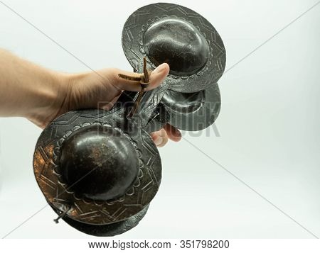 Close-up View Of Caucasian Man Holding Krakebs, A Moroccan Percussion Instrument. Concept Of Traditi