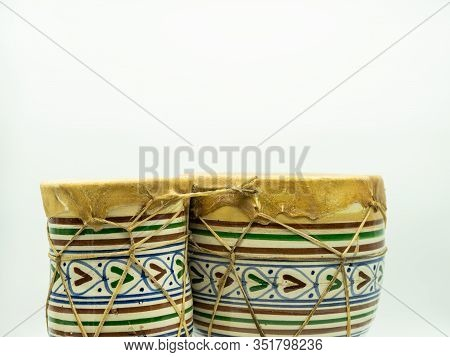 Moroccan Drums Standing Alone On A White Background With Space At The Top Of The Image For Text. Con