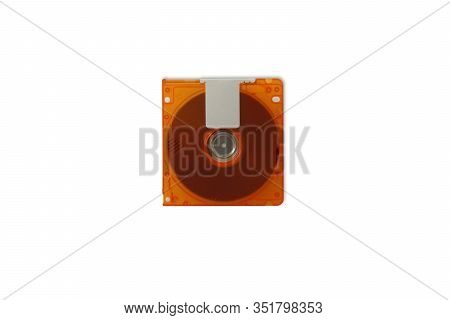 Top View Isolate Of Orange Mini Disc Md On A White Background For Data And Music Recording, Concept