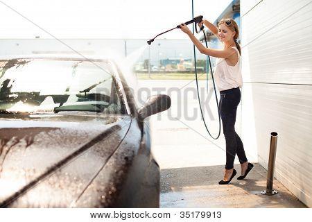 Young Woman Washing The Car