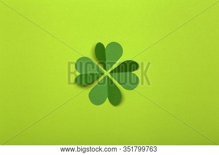 St. Patrick 's Day (st. Paddy's Day) Background Concept. Green Clover From Paper On A Green Backgrou