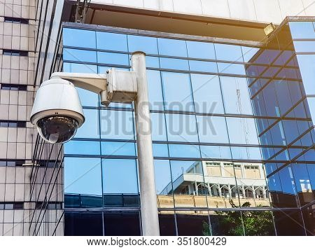 Security Surveillance Camera In Front Of Office Building Walk Way. Record Situation Around Area Stan