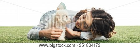 Panoramic Shot Of Woman Looking At Havanese Puppy Isolated On White