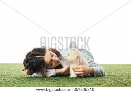 Woman Looking At Havanese Puppy And Lying On Grass Isolated On White