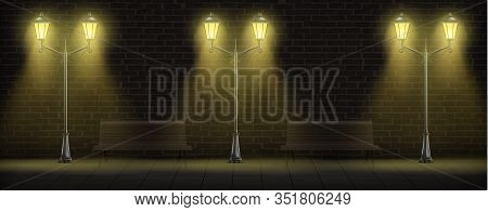 Streetlights On Brick Wall Background With Wooden Benches. Luminous Vintage Street Lights Or Lamppos