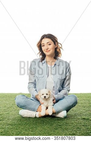 Smiling Woman With Havanese Sitting On Grass Puppy Isolated On White