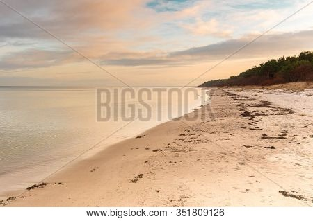 Beautiful Sea Landscape On Dramatic Cloudy Sky At Sunset Time. Calm Evening Seascape. Nature Backgro