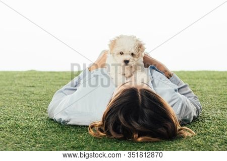 Woman Lying On Grass With Havanese Puppy Isolated On White