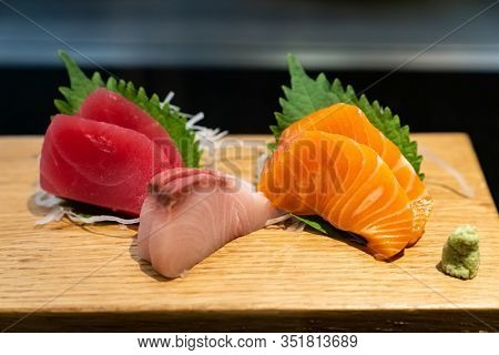 Sashimi traditional japanese cuisine, set of freshness raw salmon tuna and bass.