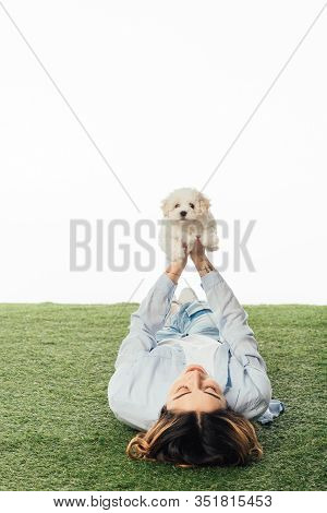 Woman Lying On Grass And Holding Havanese Puppy Isolated On White