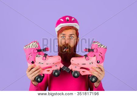 Man With Roller Skates And Helmet. Active Sport. Roller Skating Ride. Healthy Lifestyle. Bearded Man