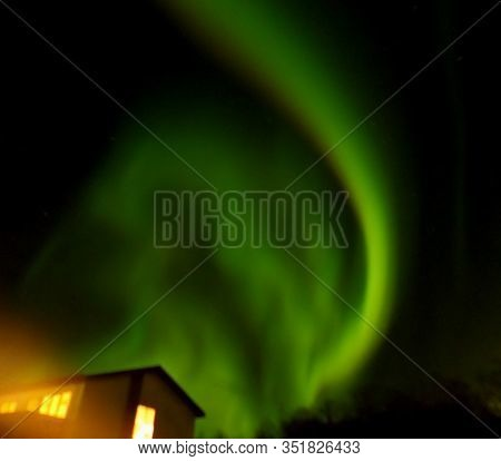 Incredible Aurora Borealis Sparkling Over A Small Town Of Northern Iceland